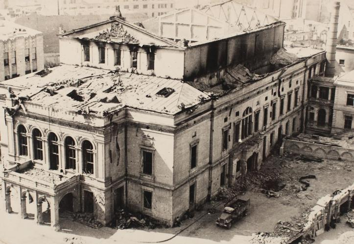 "The National Theatre, built in the XIX century. Though the damage was not irreparable and it could easily be restored (according to an official experise made after the bombing), the communists razed it to the ground, and in a twisted turn, created slogans like ""Develop teh backward culture"" when they built their own unappealing version of the theatre."